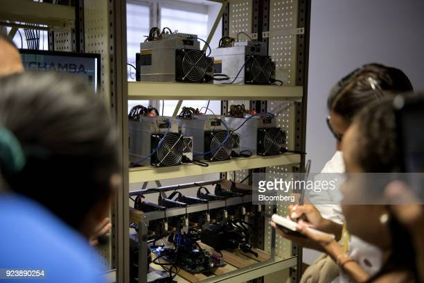 Students inspect Bitmain Technologies Ltd Antminer mining rigs inside the cryptocurrency mining farm and school at the Ministry of Youth and Sports...