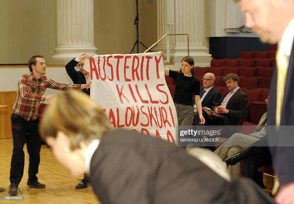 Students interrupt a seminar with a banner reading 'Austerity kills', attended by the EU Council President and Finnish Prime Minister on May 7, 2013 in Helsinki, Finland. AFP PHOTO /LEHTIKUVA / Markku Ulander FINLAND OUT