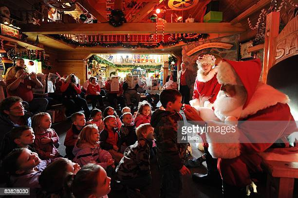 Students John Siebler of Fort White Florida and Mary Ellen Stroh of Midland Michigan dress up as Santa Claus and Mrs Claus and appear for local...