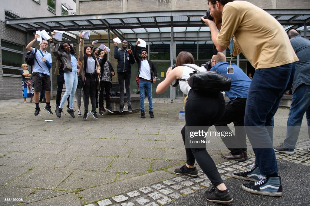 Students jump into the air for photographers after receiving their A level results at City and Islington College on August 17, 2017 in London, England. The number of students receiving the highest grades of A and A* grades has increased for the first time in six years.