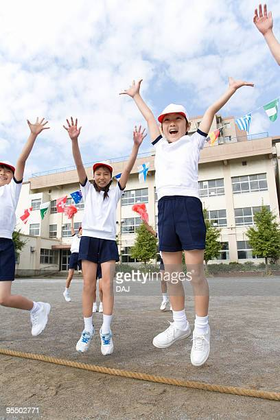 Students jumping in air