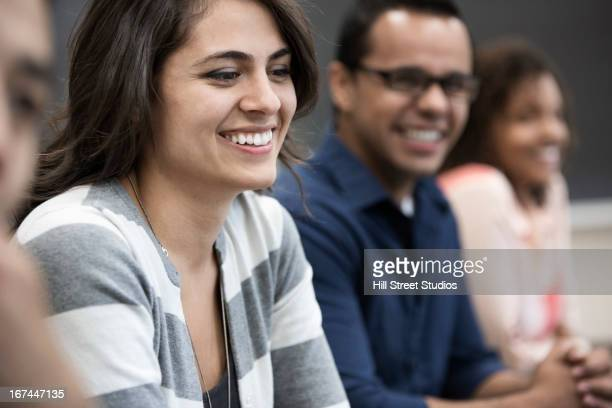 students laughing in classroom - multiculturalism stock pictures, royalty-free photos & images