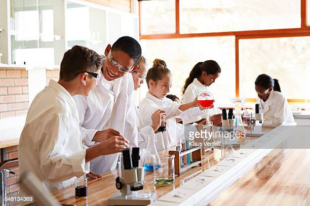 Students laughing while doing science projects
