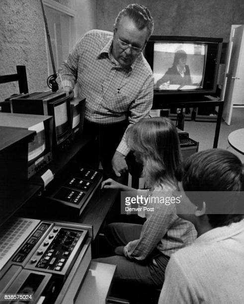 Students Lear how to edit TV Film Instructor Jim Boynton checks progress by Ba'rbara Kincade Centaurus senior and Scott Shultes at the Career...