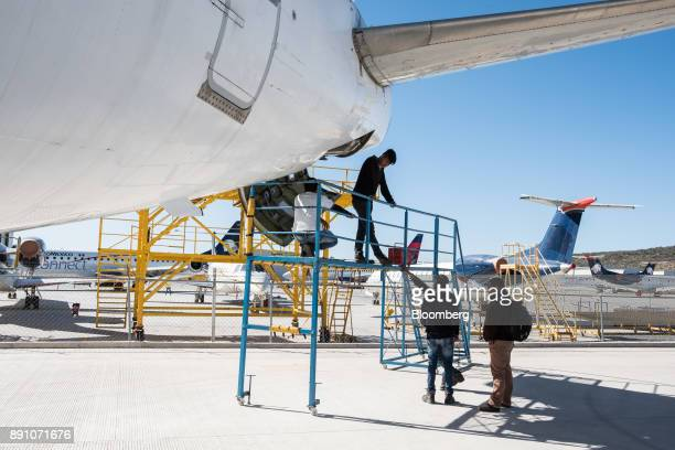 Students learn how to repair the airconditioning unit on an an aircraft at the College of Technical Professional Education of the State of Mexico in...