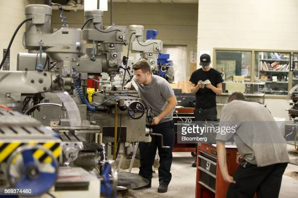 Students learn precision metalwork on a milling machine at the vocational training centre in Montmagny Quebec Canada on Tuesday Oct 31 2017 In this...