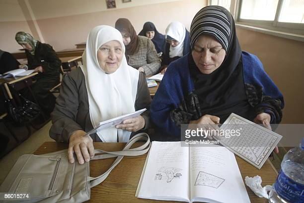 Students learn the alphabet in a classroom of 12 women of different ages all eager to learn to read and write at the literacy centre of Umm alHareth...