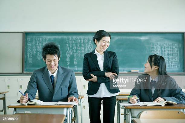 Students learning from a teacher