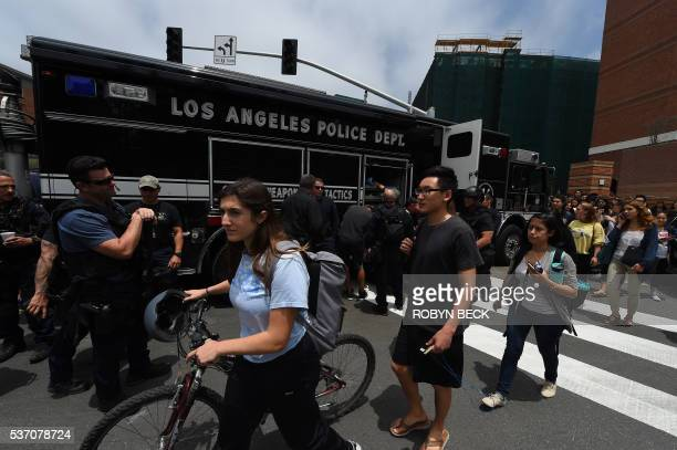 Students leave campus at the University of California in Los Angeles after the allclear was given following a shooting June 1 2016 in Los Angeles...