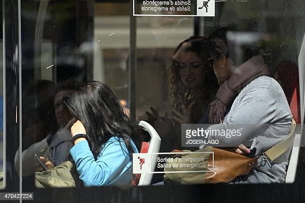 Students leave the Joan Fuster Institute in a bus in Barcelona on April 20 2015 after a student allegedley broke into the school armed with a...