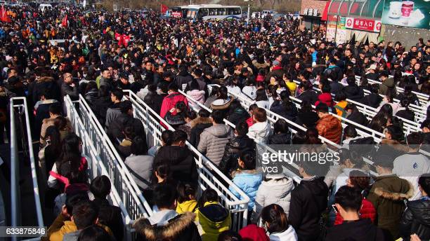 Students leave the Shungeng International Convention and Exhibition Center during the College Entrance Exam for Art on February 5 2017 in Jinan...