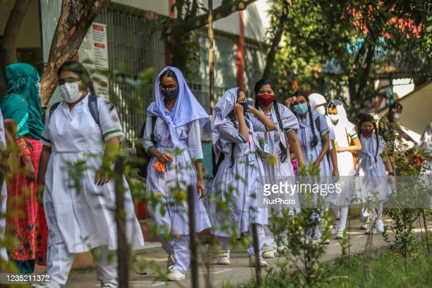 Students leave their class at the Tejgaon Government Girls' High School, in Dhaka on September 12 as Bangladesh schools reopened after 18 months in...