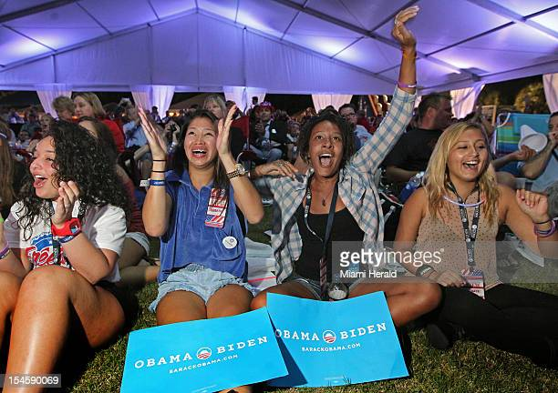 Students left to right Esteffany Paulino Stefani Silva Amanda Nguherimo and Carla Recalde watch the presidential debate outside at Lynn University on...