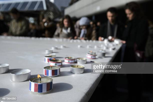 Students light candles with colours of French and Lebanese national flags during a gathering on November 16, 2015 at the Swiss Federal Institute of...