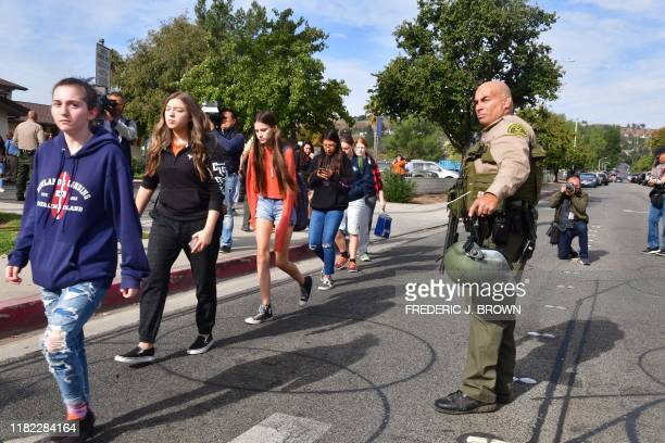 Students line up after a shooting at Saugus High School in Santa Clarita California on November 14 2019 At least four people were injured in a...