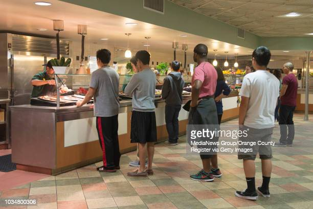 UCI students line up for dinner at UCI's Mesa Commons UCI dinning halls use environmentally friendly practices by composting their waste food which...