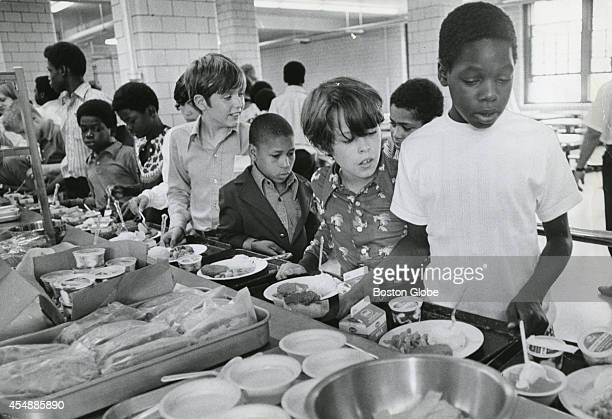 Students line up for lunch at the Patrick F Gavin Middle School in South Boston on Sept 13 on the second day of school under the new busing system...