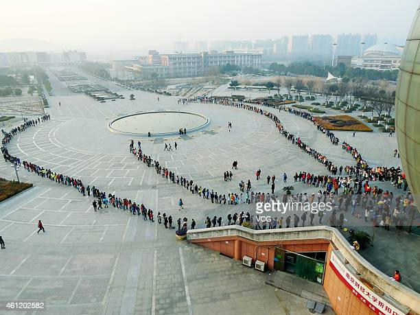 Students line up in front of the library for self study room in the morning at Nanjing University Of Finance & Economics on January 8, 2015 in...