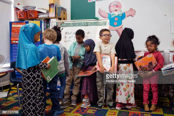 Students line up with their books for library in Lynn Adams' kindergarten class at Longley Elementary School Longley's demographic makeup has changed...