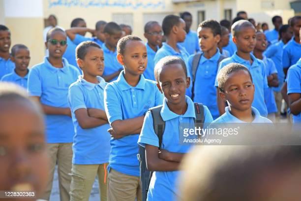 Students lineup in school garden as schools begin in the Somalian capital Mogadishu on September 01 2020 under the measures taken against the...