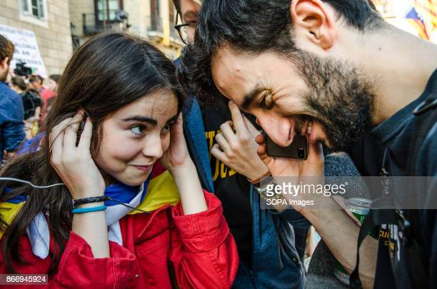 Students listen carefully their mobile phone to hear the institutional declaration of the president Carles Puigdemont in Plaza Sant Jaume Students...