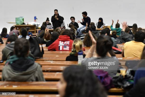 Students listen during a general assembly in Nanterre University west of Paris on May 15 a week after having voted an unlimited blockage of their...