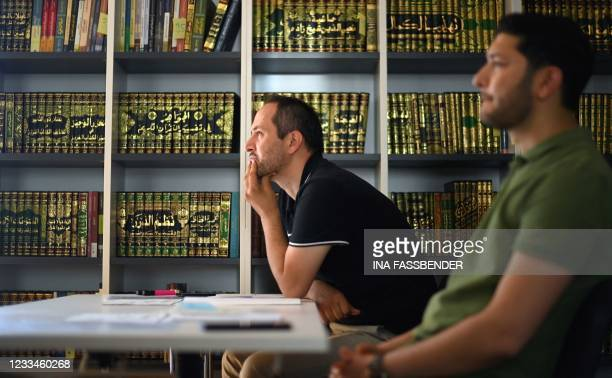 Students listen during a lesson in the classroom of the Islamkolleg Deutschland in Osnabrueck, western Germany on June 14, 2021. - The first block...