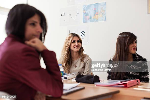 Students listen to a presentation by their teacher during their English class at the American University of Iraq Sulaimani