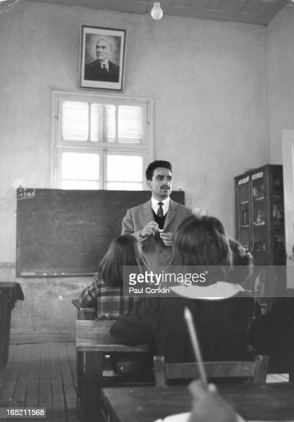 Students listen to an unidentified male teacher in a classroom Turkey ca 1960s The portrait above the window is of Kemal Ataturk the first President...