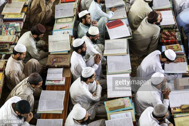 Students listen to Islamic cleric Maulana Samiul Haq chancellor of Darul Uloom Haqqania madrassa and former senator not pictured delivering a lecture...