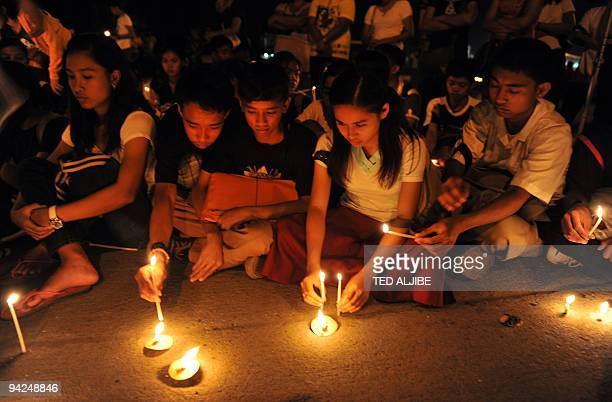 Students listen to speeches during an indignation rally in the town of Koronadal south Cotabato province on November 25 as investigators in Ampatuan...