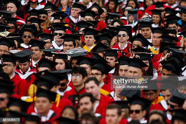 Students listen to US President Barack Obama while he speaks after receiving an honorary doctorate of laws during the 250th anniversary commencement...