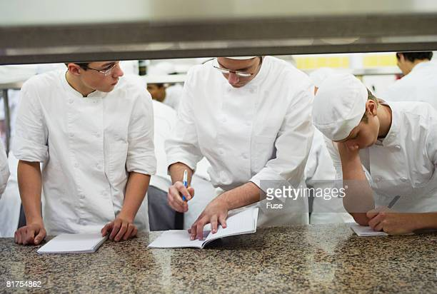 Students Listening to Instructor in Culinary School