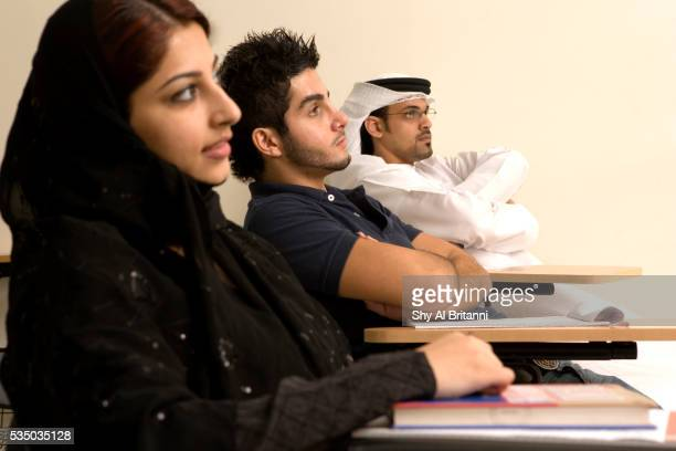 students listening to the teacher's lecture - gulf countries stock pictures, royalty-free photos & images