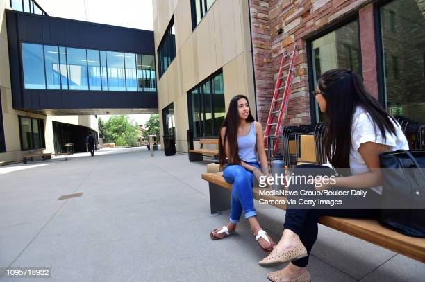 CU students Lluvia Macia left and Adela Aguirre talk outside the Center for Academic Success and Engagement on Friday on the University of Colorado...