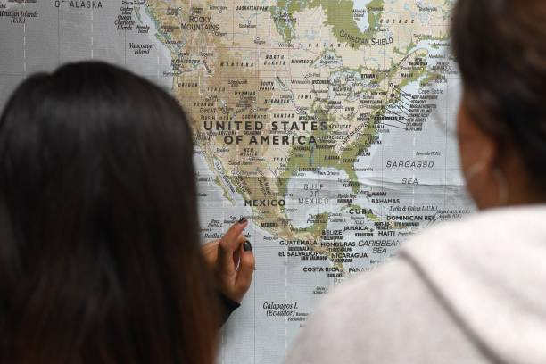 Students look at a map of North, Central and Central America during ...