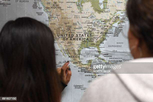 Students look at a map of North Central and Central America during a history class taught in Spanish in a Dual Language Academy class at Franklin...
