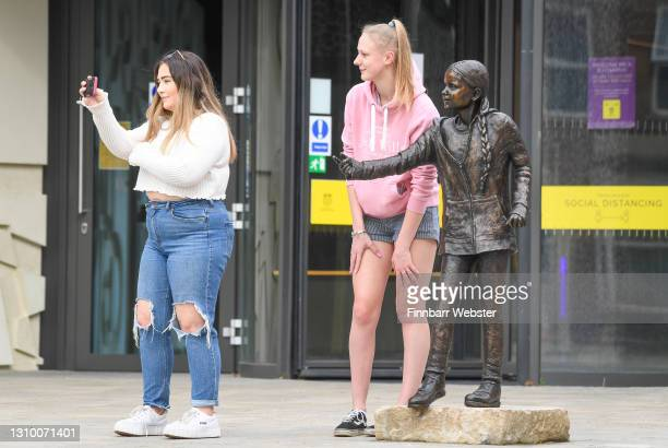 Students look at the Greta Thunberg statue on March 31, 2021 in Winchester, England. The school's student union was critical of the money spent on...