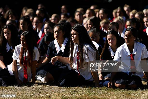 Students look on during a visit to Palmerston North Girls' High School by New Zealand Prime Minister John Key on March 3 2016 in Palmerston North New...