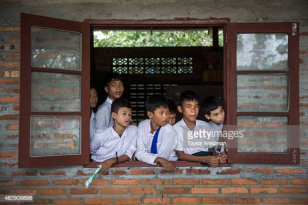 Students look out the window of their classroom in a village inside the planned Dawei SEZ on August 3 2015 in Mudu Myanmar The controversial...