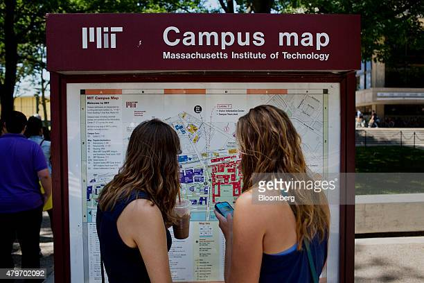 Students look over a map at the Massachusetts Institute of Technology campus in Cambridge Massachusetts US on Tuesday June 30 2015 Massachusetts...
