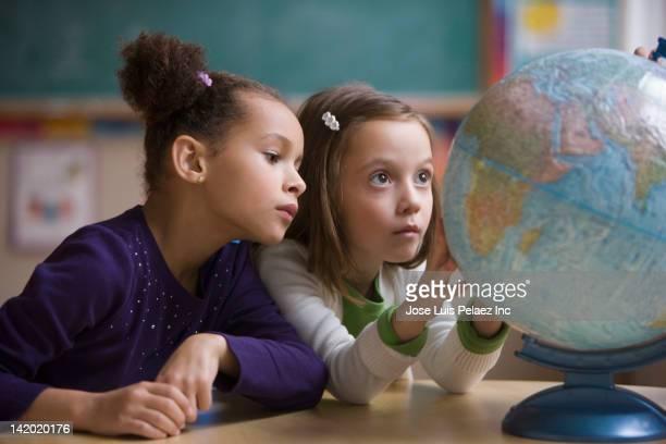 students looking at globe in classroom - 自然地理学 ストックフォトと画像