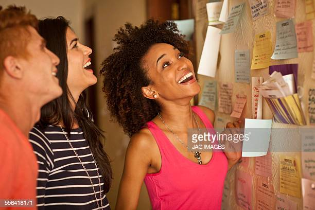 Students looking at notice board