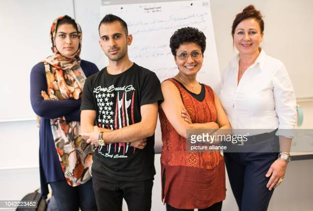 Students Mahdia and Alireza pose with instructors Sabine Schumny and MahinDehghani at the Friedrichshain adult education centre inBerlin Germany 13...