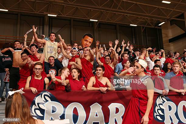 Students make noise to try and win a pizza as they stand in front of a big head cut out of Anthony Ireland of the Loyola Marymount Lions during a...