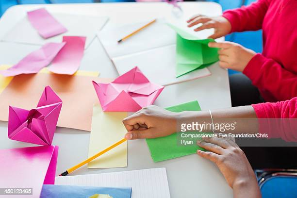 students making origami in classroom - art and craft product stock pictures, royalty-free photos & images