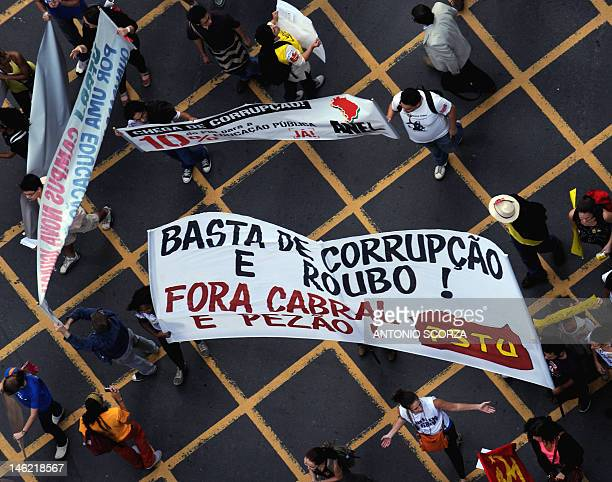 Students march along the Rio Branco avenue in downtown Rio de Janeiro during a protest against corruption and asking for a better education budget on...