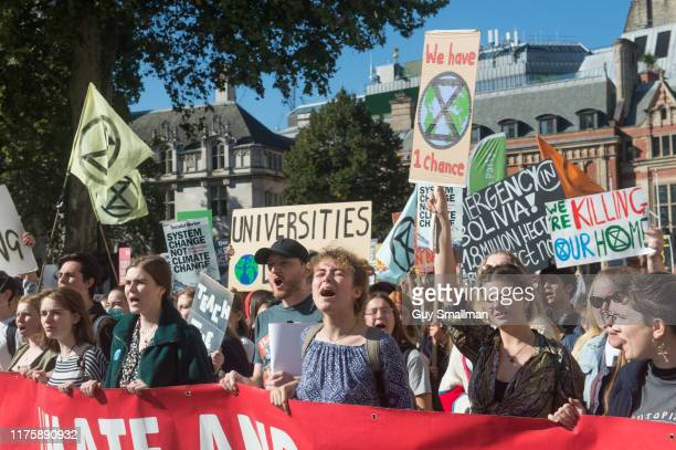 Students march around Parliament square in support of the global climate strike on September 20 2019 in London England
