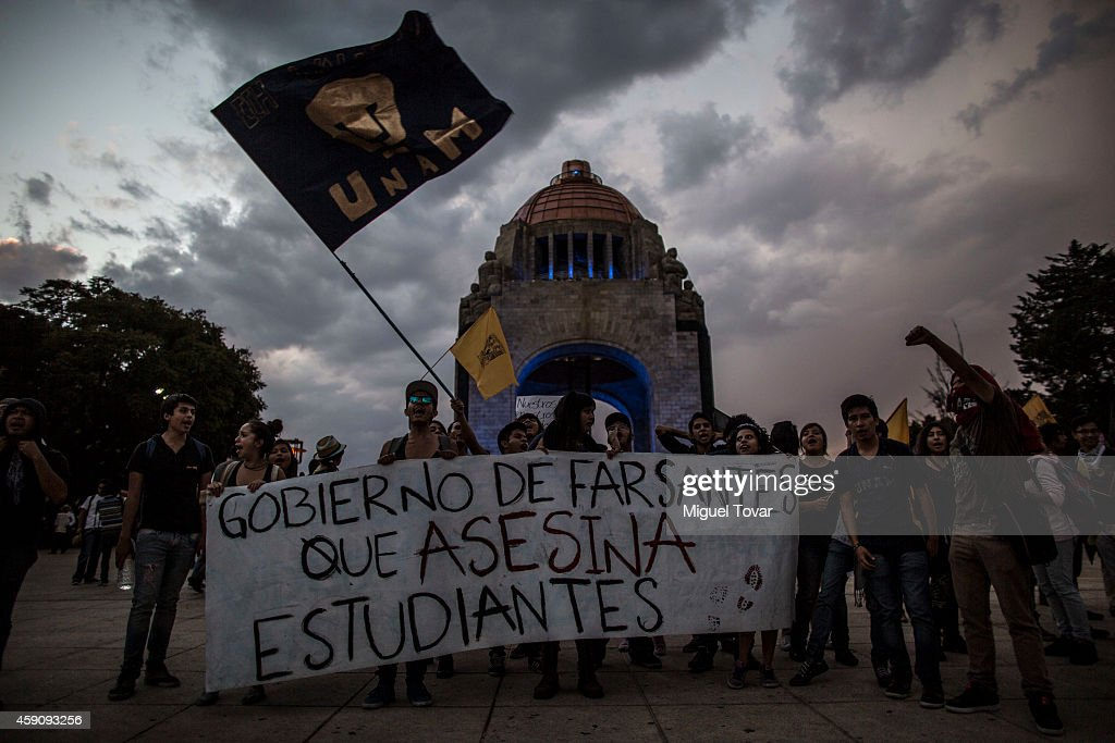 UNAM students march during a demonstration against Mexico's government who suggests that 43 missing students were murdered and their charred remains tipped in a rubbish dump and a river in Guerrero, Mexico, on November 16, 2014 in Mexico City, Mexico.