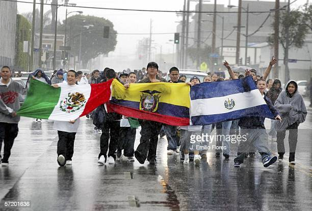 Students march in streets carrying latin american flags to protest against a proposed immigration policy March 28 2006 in Los Angeles California...